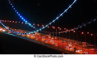 Heavy traffic on suspended bridge - Night traffic on Trans...