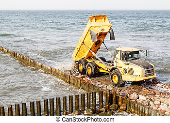 heavy truck during the construction of a breakwater