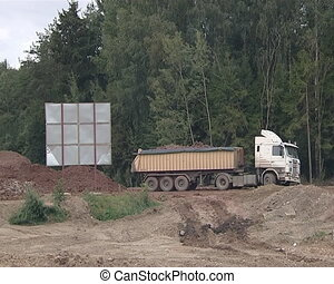 Heavy truck loaded with ground.