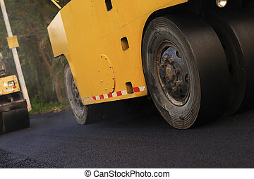 Heavy Vibration roller compactor at asphalt pavement works ...