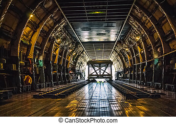 Heavy weight cargo airplane - Loading heavy weight cargo to...