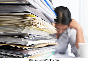 Heavy workload concept with pile of paper and woman on...