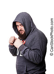 Heavyweight boxer with a big beard in the hood should clenched f
