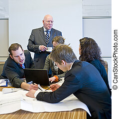 Hectic meeting - A hectic meeting, with five people working...