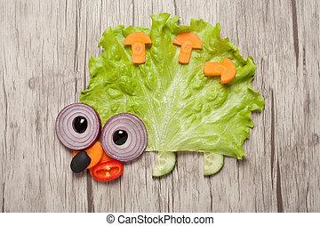 Hedgehog made of vegetables on table