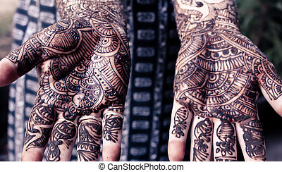 heena is on both hands - retro style - Henna is applied to...