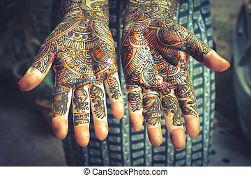 heena is on both hands - vintage style - Henna is applied to...