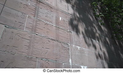 Height Scale Engraved Into an Old Canal Rock Wall - Tilt...