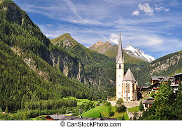 Heiligenblut church in front of Grossglockner peak, Austria