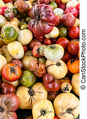 Heirloom tomatoes on display at the farmer s market