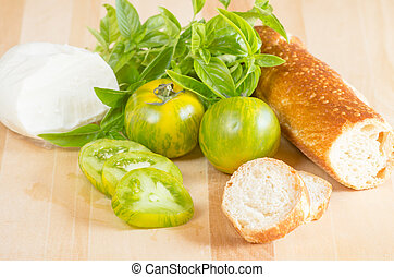 Heirloom tomatoes with bread and cheese