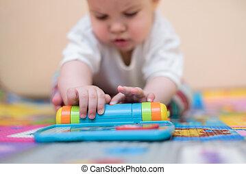 heiter, kind, spielen spielzeugen, boden