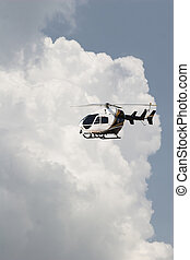 helecopter & Clouds - Storm clouds building, helecopter...