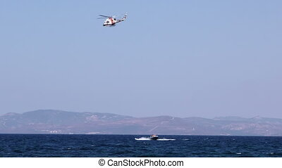 Helicopte and the Boat in Sea