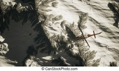 helicopter above mountains in snow