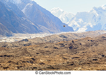 Helicopter above the glacier Inelchek. Kyrgystan, Tian Shan