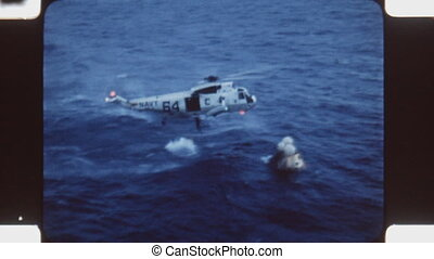 Helicopter and Apollo 11 module. - Sea King helicopter drops...