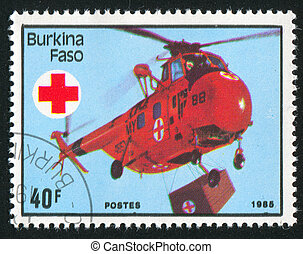 helicopter - BURKINA FASO - CIRCA 1985: stamp printed by...