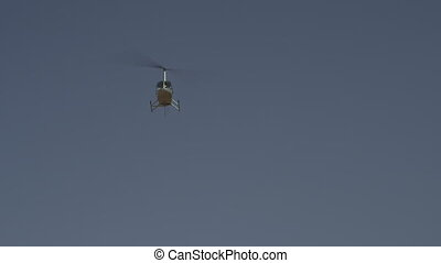Helicopter coming in to land at the Outback, NT - Low-angle...