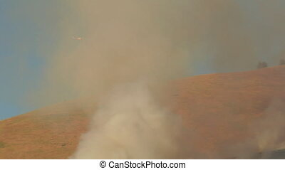 helicopter flies through fire smoke