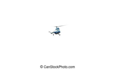 Helicopter flight against the light sky