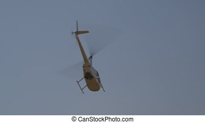 Helicopter flying away, Outback, NT - Low-angle still shot...