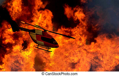 Search and rescue helicopter flying by a bushfire