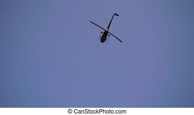 Helicopter flying in a sky