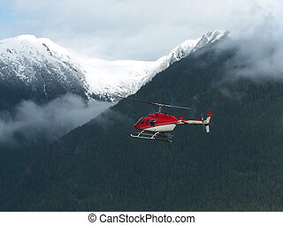 Helicopter flying in bc canada
