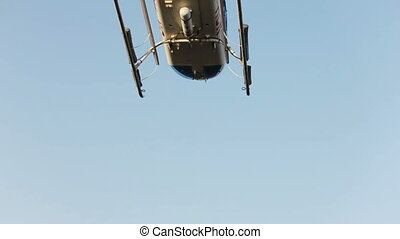 Helicopter flying in the clear blue sky. Santorini island, Greece