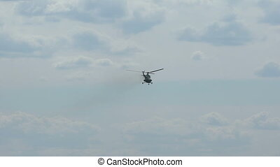 Helicopter flying in the sky. - Helicopter flying in the sky