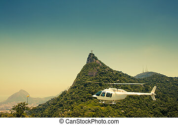 Helicopter in air in front of Corcovado Rio De Janeiro Brazil