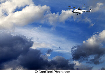 Helicopter in blue sky with clouds at nice day