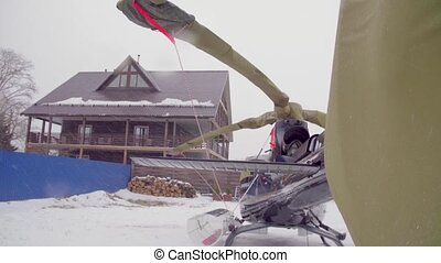Helicopter in ski touring lodge. Snowfall. Heliskiing in...