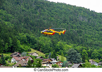 helicopter in the french alps mountains