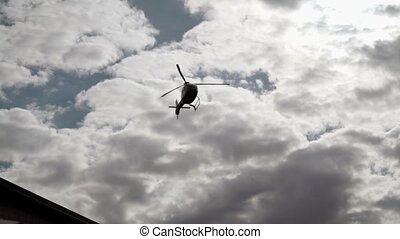 Helicopter landing shot - Helicopter landing at cloudy day...