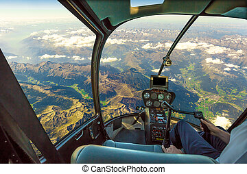 Helicopter on mountain landscape - Helicopter cockpit flying...