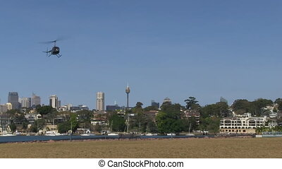 Helicopter on sky with buildings. - A medium shot of a...