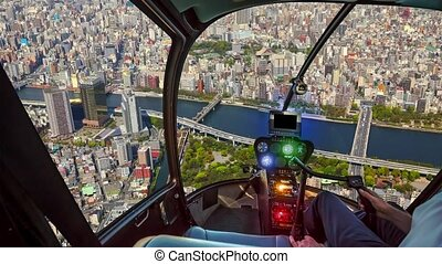 Helicopter on Tokyo skyline Sumida river