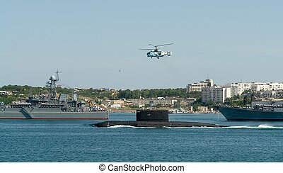helicopter over a submarine