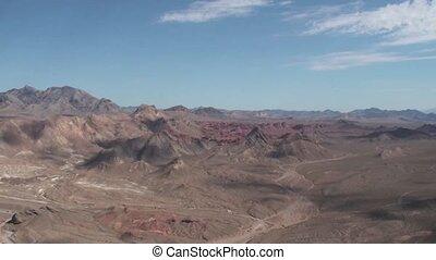 Helicopter over desert - Helicopter flying over the desert