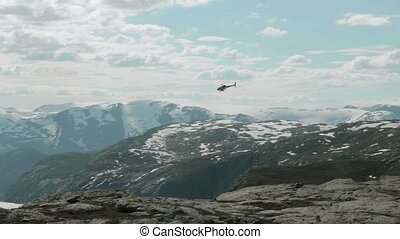 Helicopter over the mountains in Norway