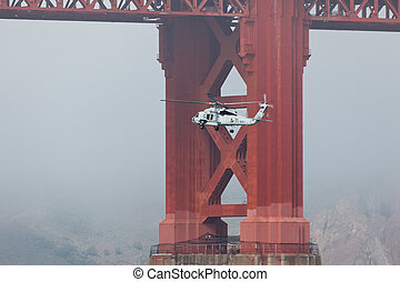 Helicopter Passes Under Golden Gate