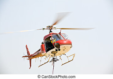 helicopter picking up cargo