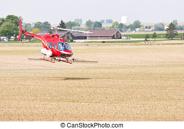 Helicopter spraying crops in Colorado, USA