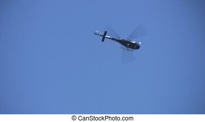 Helicopter. - A helicopter flies overhead.