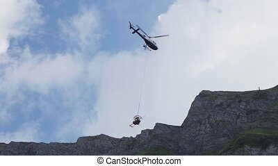 Helicopter takeoff in the mountains, repair work in the mountain
