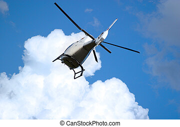 Helicopter - The helicopter in the sky with clouds