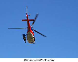Tourist helicopter in flight seen from underneath
