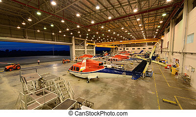 helicopters are parking in the hangar